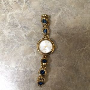 Gold watch with sapphire accents